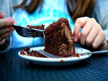 The science behind stress eating: Why physical and emotional stress makes us crave high-sugar, high-fat foods or both - Firstpost