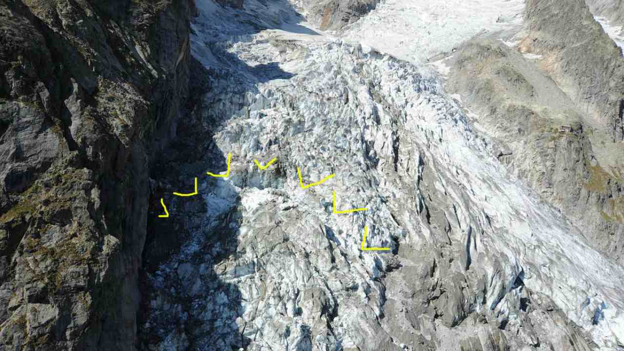 About 250,000 cubic meters of ice (highlighted in yellow) are at imminent risk of collapse from the Planpincieux glacier along the Italian side of the Mont Blanc massif. Italian authorities have closed roads and evacuated mountain huts. image credit: Courmayeur Press Office/EPA