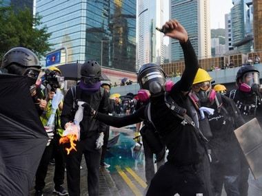 Hong Kong returns to violence after brief lull; protesters sing' God save the Queen', ask Britain to step up pressure on China