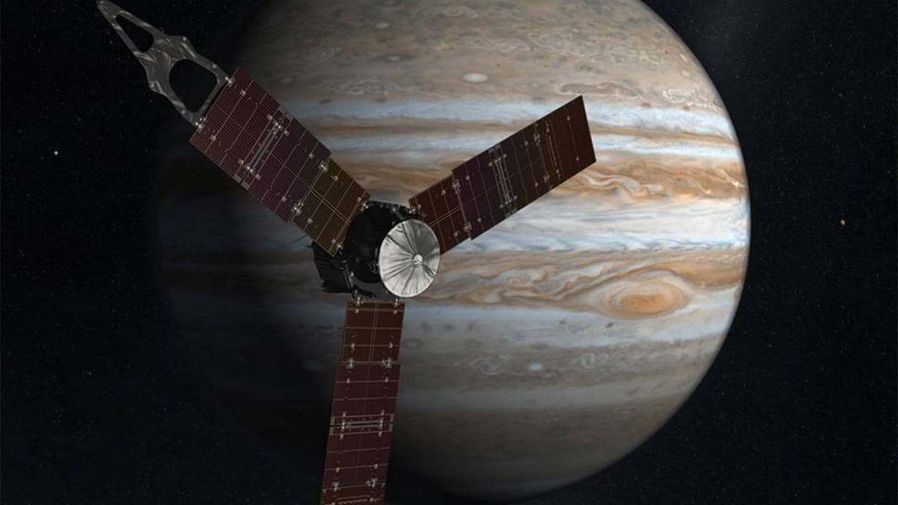 Artist illustration of the Juno satellite with Jupiter in the background. image credit: NASA