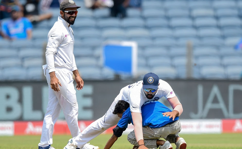 A fan entered the field uninvited to touch Rohit Sharma's feet and in the process made Hitman tip over him. Former India captain Sunil Gavaskar who was commentating at that time, fumed at the happening, saying that security inside the stadium should be more alert to avoid such instances. AFP