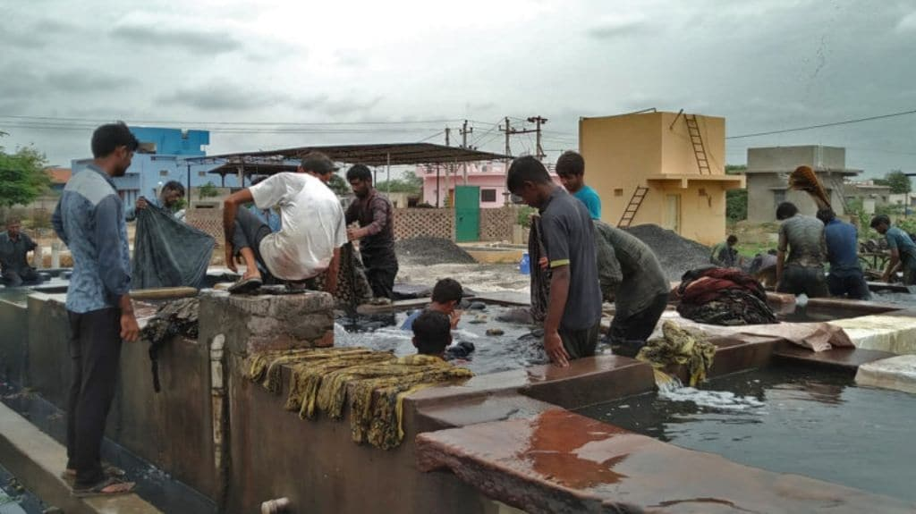 Washing of the cloth takes place in a community washing area. Photo by Azera Parveen Rahman.