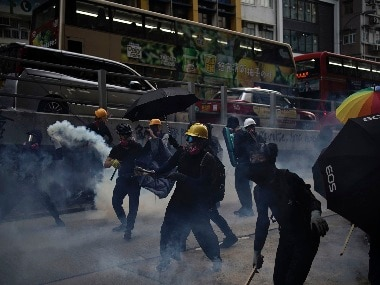 'Five demands, not one less': Hong Kong protesters erect barricades, throw firebombs; police fire tear gas, use water canons