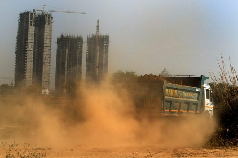 Dust and pollution rising from a construction site in Gurugram. image credit: Manoj Kumar.