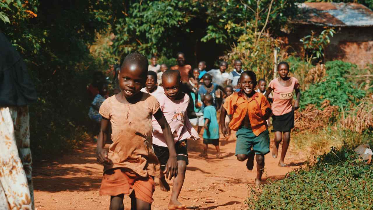 Children running and playing in their village.