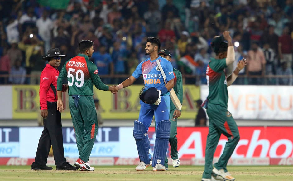Shreyas Iyer shakes hands with Soumya Sarkar following the Men in Blue's eight-wicket win to equal the three-match series 1-1. This was a perfect way to cap off Rohit Sharma's 100th T20I. AP