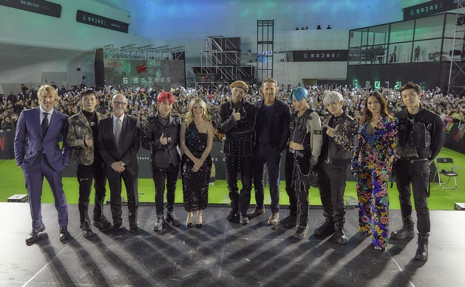 Ryan Reynolds, Melanie Laurent, and Adria Arjona, as well as director Michael Bay and producer Ian Bryce meet the K-pop band Exo | Press Release