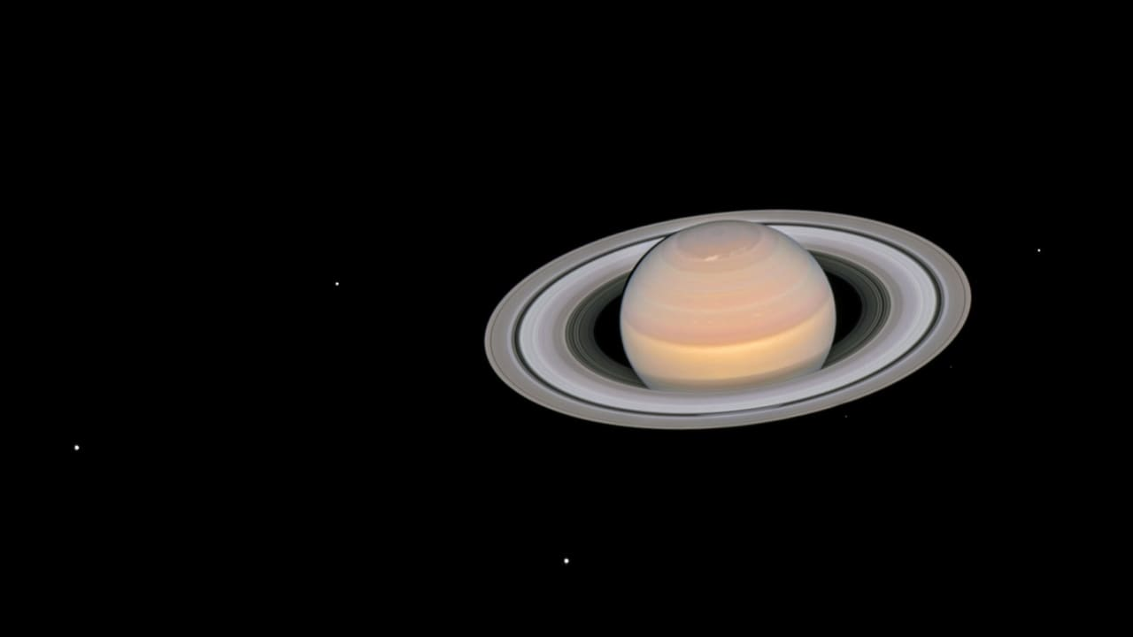 Auroras at Saturn's poles could be the heat source that keeps the upper layers of the planet hot, NASA's Cassini finds