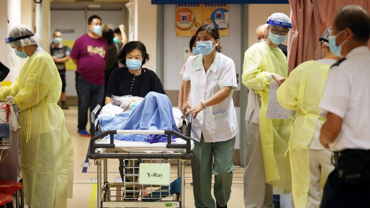 A patient infected with the virus gets wheeled through the hospital. Image credit: Getty