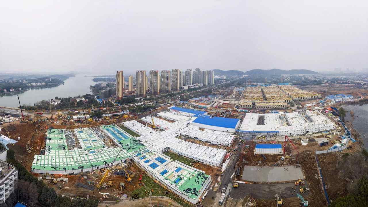 The Huoshenshan temporary field hospital under construction is seen as it nears completion in Wuhan in central China's Hubei Province, Sunday, Feb. 2, 2020. The Philippines on Sunday reported the first death from a new virus outside of China, where authorities delayed the opening of schools in the worst-hit province and tightened quarantine measures in a city that allow only one family member to venture out to buy supplies. (Chinatopix via AP)/XMAS814/20033372936121/CHINA OUT/2002021140