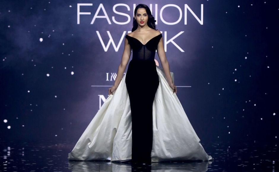 On Day 3, Nora Fatehi walked the ramp as showstopper for Gauri & Nainik whose collection was filled with sleek gowns, lush velvets and tulle truffles. Fatehi wore a stunning black, sheath gown with a long, white train.