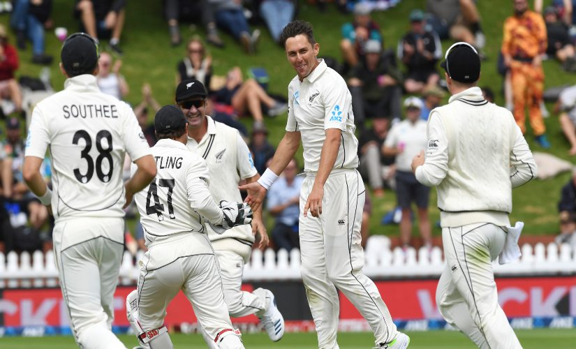 New Zealand's Trent Boult, centre, celebrates the dismissal of India's Mayank Agarwal for 34 during the first Test between India and New Zealand. AP