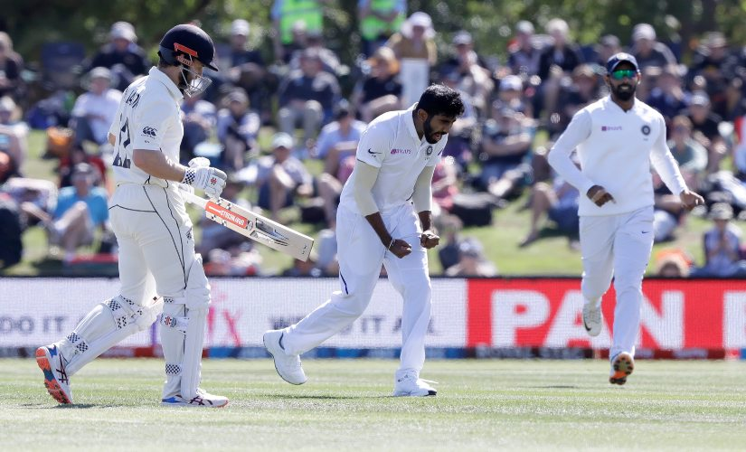 India's Jasprit Bumra, centre, celebrates after dismissing New Zealand's Kane Williamson, left, during play on day two of the second Test between New Zealand and India. Bumrah returned with figures of 3/62. AP