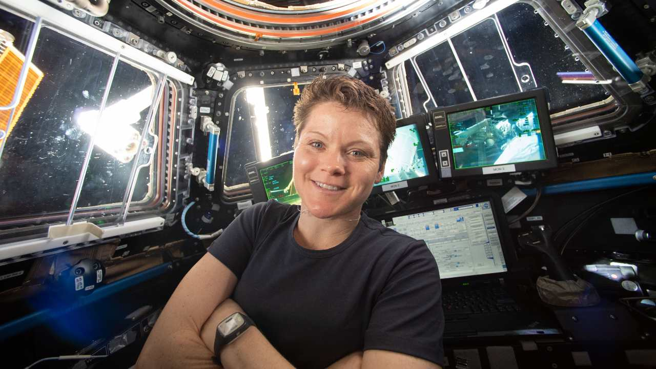 NASA astronaut Anne McClain poses in the cupola of the International Space Station while she works with the Canadarm2 robotics maneuvers. Image credit: NASA