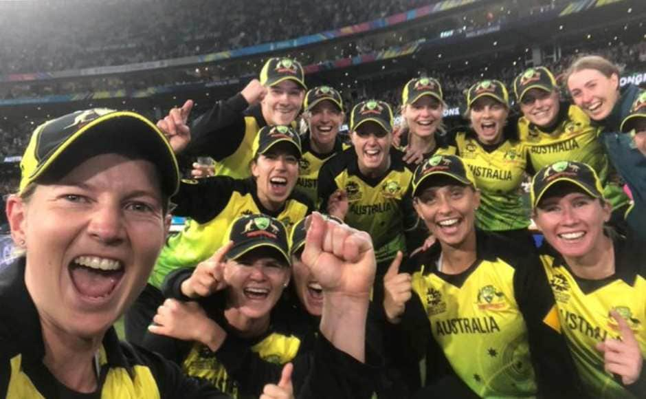 The triumphant Aussie women pose for a photo at the end of the contest. Twitter @T20WorldCup
