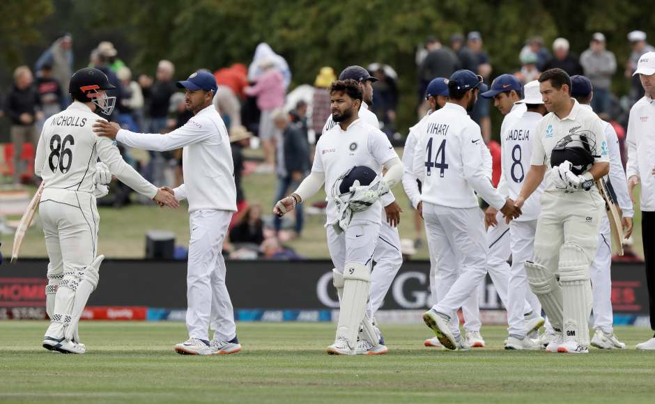 New Zealand and India players shake hands after the conclusion of the second Test. AP