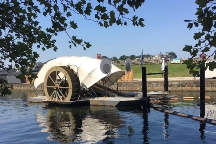 "The Waterwheel Powered Trash Interceptor, also known as ""Mr. Trash Wheel,"" temporarily sported large googly eyes in 2015. Three such devices are now operating in Baltimore, Maryland. Image courtesy of Clearwater Mills LLC."