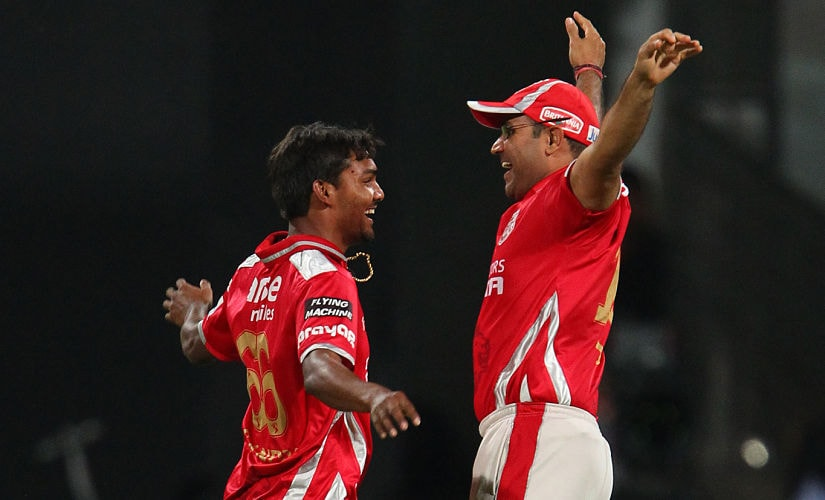 Sandeep Sharma celebrates the wicket of Chris Gayle with Virender Sehwag in 2014 IPL. Sportzpics