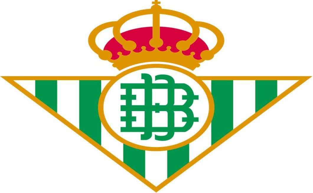 Found in 1907, the Real Betis logo is truly unique in LaLiga due to its unusual shape. The green and white colour palette is inspired by Glasgow Celtic, Real Betis used to play in blue and white but one of the founders – Manuel Ramos Asensio – had forged relationships in Scotland and managed to secure the Celtic hoops for his own team. The stylish monogrammed letters that sit in the centre of the logo stand for Betis Balompié. The crown atop the logo represents the Royal patronage granted by King Alfonso VIII in 1914.