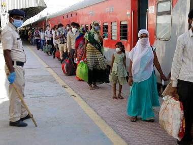 File image of migrants boarding special trains. AP