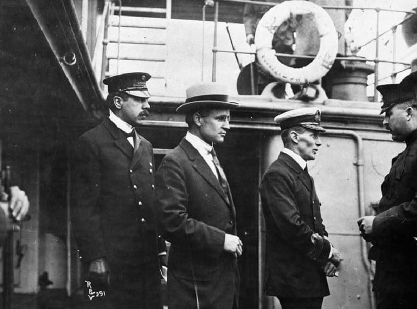 )Inspector Reid, H.H. Stevens and Capt. Walter J. Hose on board the Komagata Maru. Image from Wikimedia Commons