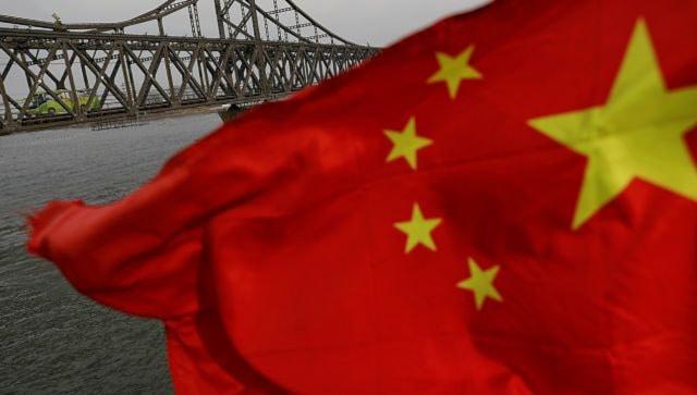 China rails at 'dark history' of US intelligence as Joe Biden orders probe into COVID-19 origins