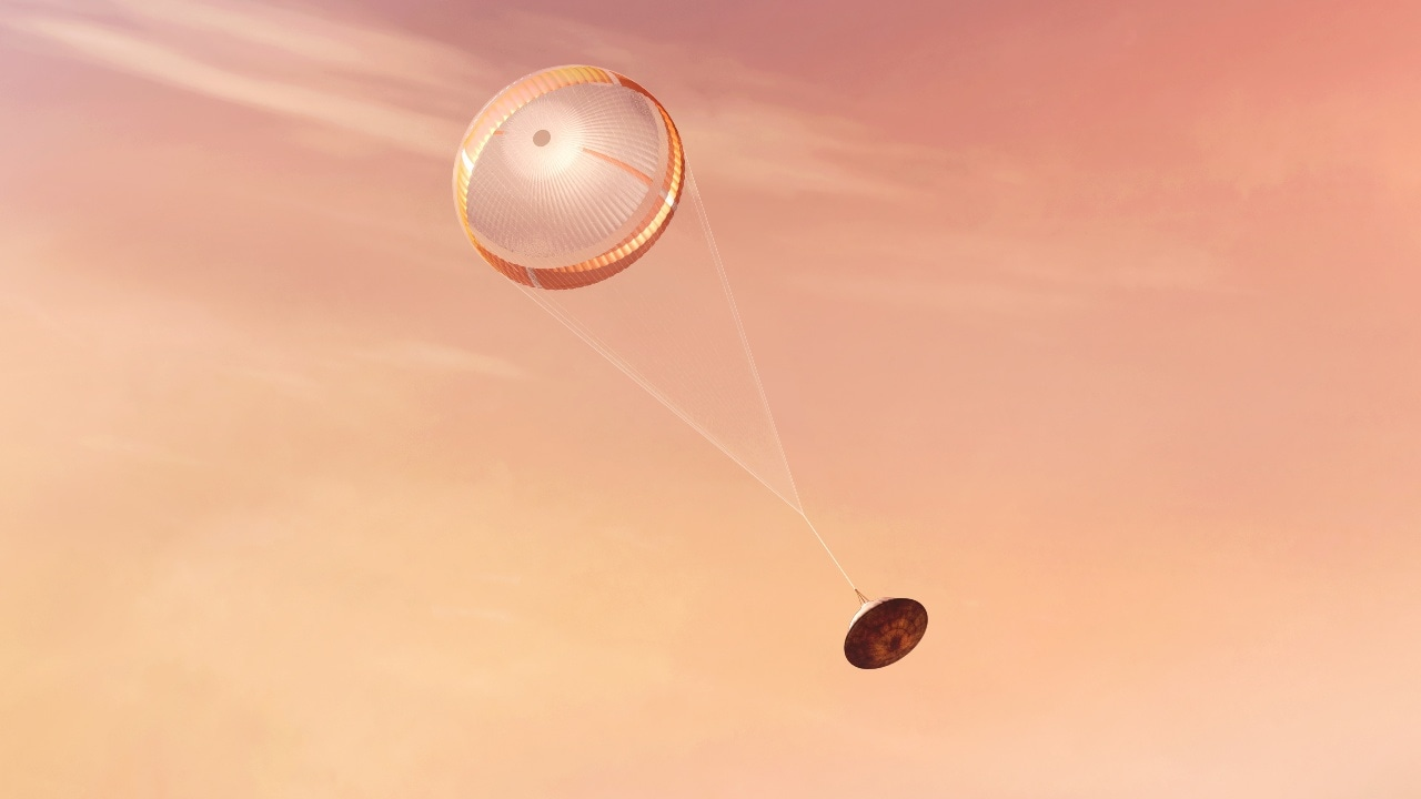 The descending spaceship after the parachute has deployed.  Image Credit: NASA / JPL-Caltech