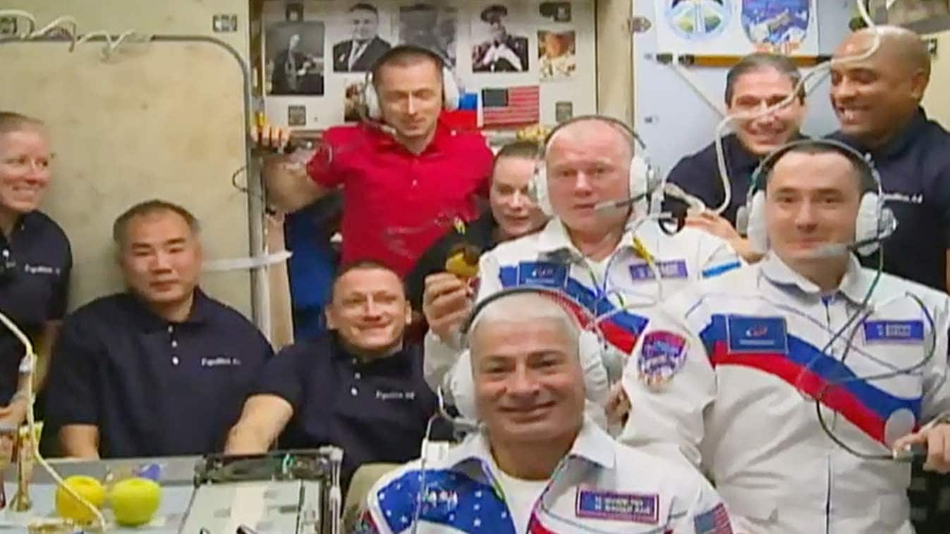 Two cosmonauts, one astronaut arrive at the International Space Station