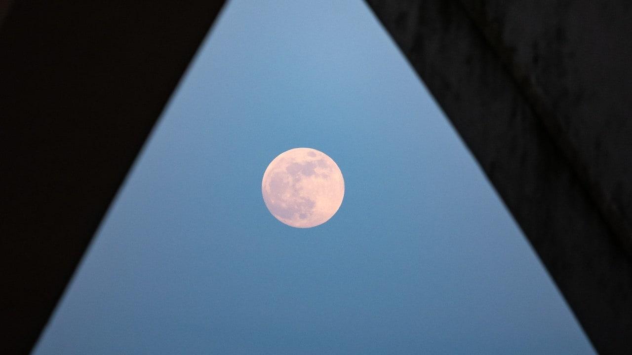 The Moonrise is seen from under the Woodrow Wilson Memorial Bridge in Virginia, USA. Image credit Flickr/NASA Bill Ingalls