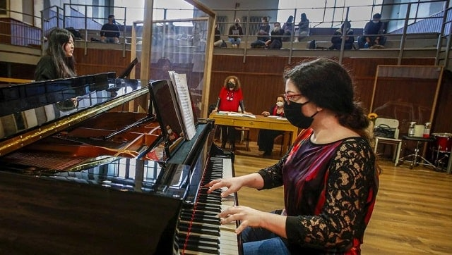 Whatever the instrument, students at Italy's oldest and largest music conservatory have been playing behind transparent screens during much of the pandemic. Image via The Associated Press/Antonio Calanni
