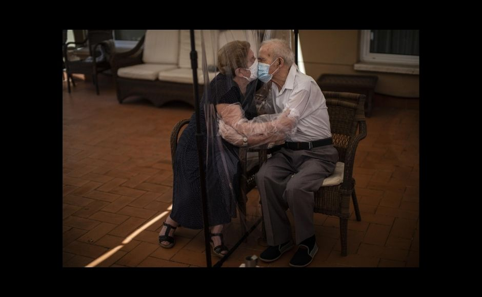 AP's chief photographer in Spain, Emilio Morenatti, won the feature photography prize. Work by 10 AP photographers won the breaking news prize.   In the picture: Agustina Cañamero, 81, hugs and kisses her husband Pascual Pérez, 84, through a plastic film screen to avoid contracting the coronavirus at a nursing home in Barcelona, Spain, on 22 June, 2020. Even when it comes wrapped in plastic, a hug can convey tenderness and relief, love and devotion. The fear that gripped Agustina Cañamero during the 102 days she and her 84-year-old husband spent physically separated during Spain's coronavirus outbreak dissolved the moment the couple embraced through a screen of plastic film. The image was part of a series by Associated Press photographer Emilio Morenatti that won the 2021 Pulitzer Prize for feature photography. Photo via The Associated Press/Emilio Morenatti