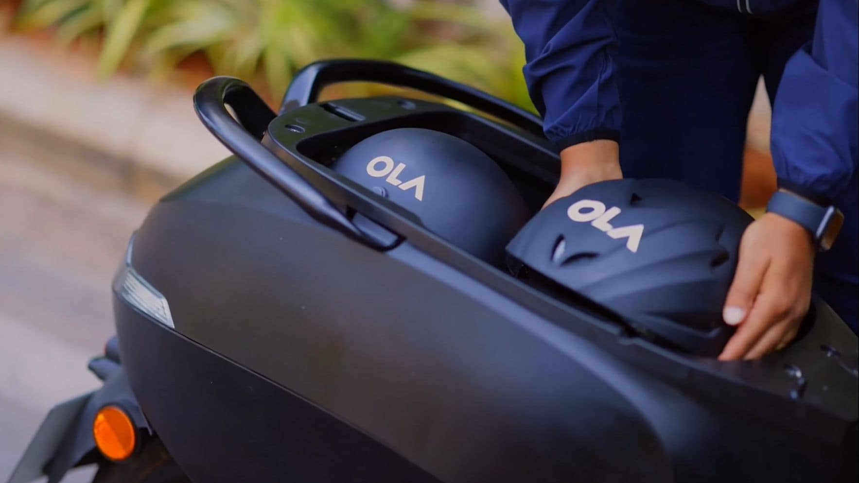 The Ola electric scooter can hold two half-face helmets in the storage bay under the seat.Image: Ora Electric