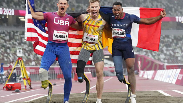 Gold medallist Germany's Markus Rehm (centre), silver medallist France's Dimitri Pavade (right) and bronze medallist United States' Trenten Merrill celebrate after the men's long jump T64 final. AP Photo