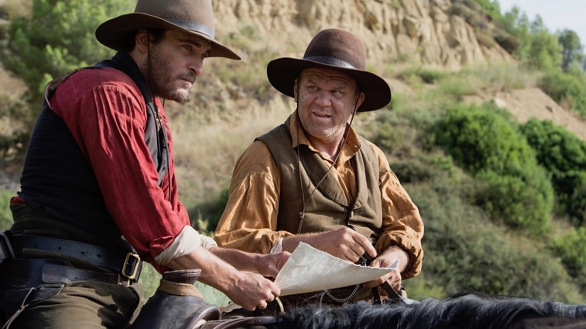 Joaquin Phoenix and John C Reilly in The Sisters Brothers. Image via Twitter