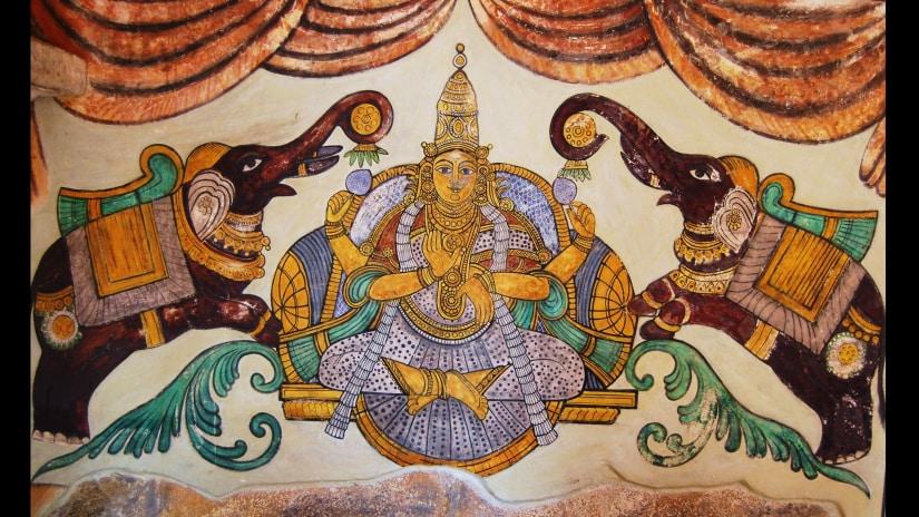 A painting of the goddess Lakshmi at Thanjavur Temple. Image via Wikimedia Commons