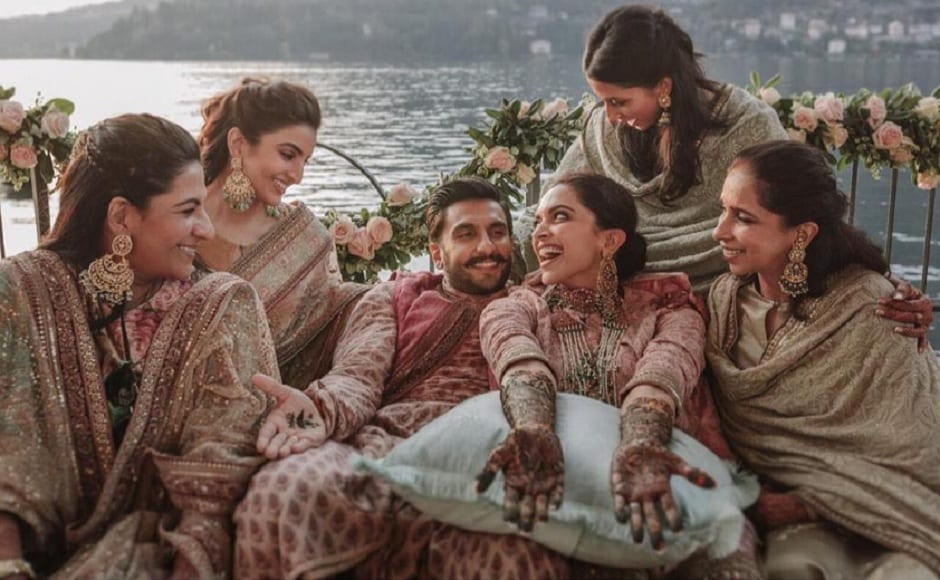 The couple pose with their friends and family by the lake. Image via Twitter/@RanveerOfficial