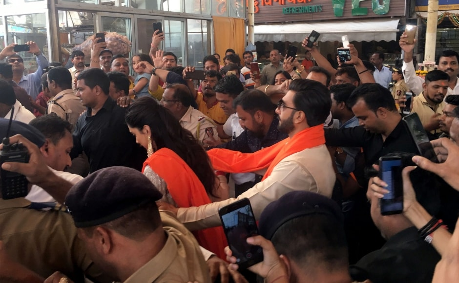 Ranveer Singh escorts wife Deepika Padukone through a crowd of fans thronging the couple. Sachin Gokhale