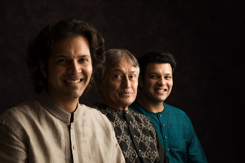 Amjad Ali Khan (M) with his two sons Amaan and Ayaan. Image via NCPA.