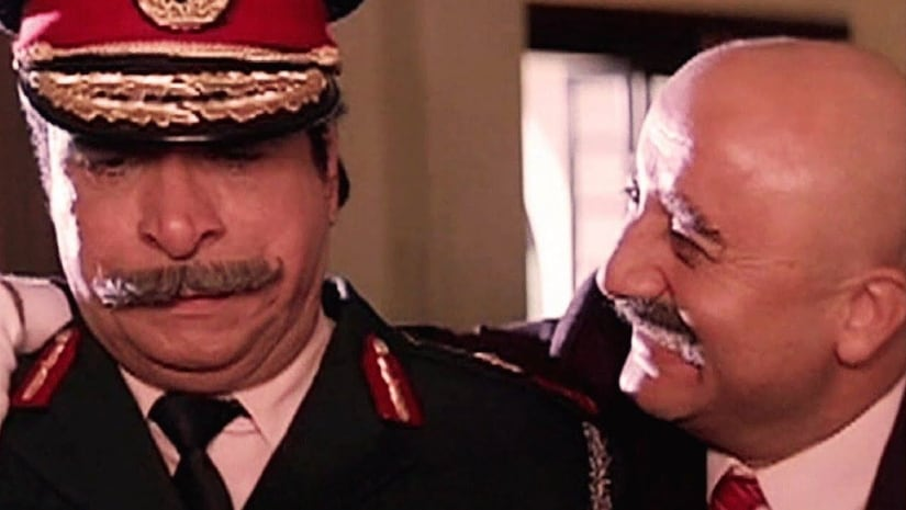 Still from Hum featuring Kader Khan (left) and Anupam Kher