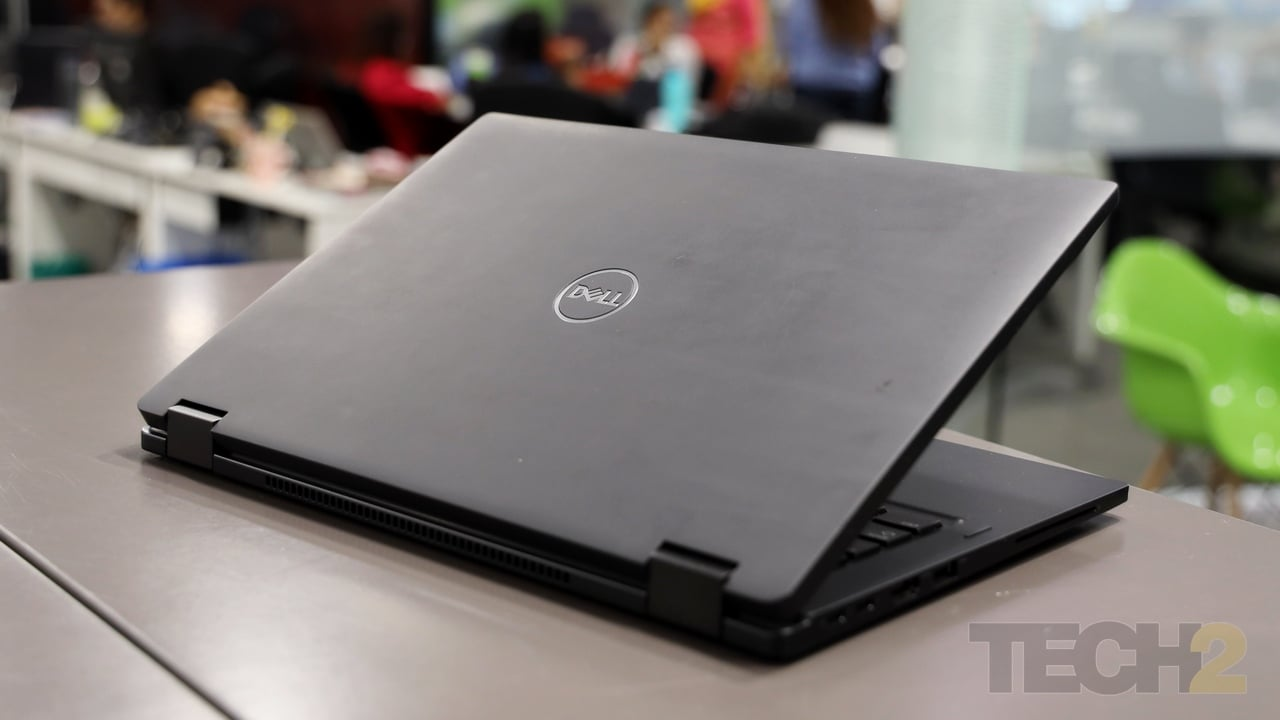 The back of the laptop tends to pick up dirt over time thanks to the soft plastic coating. Image: tech2/ Shomik