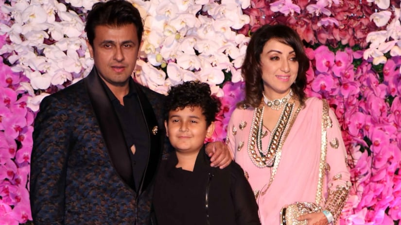 Sonu Nigam with his family attend Akash-Shloka's wedding reception at Jio World centre in Mumbai. Firstpost/@Sachin Gokhale