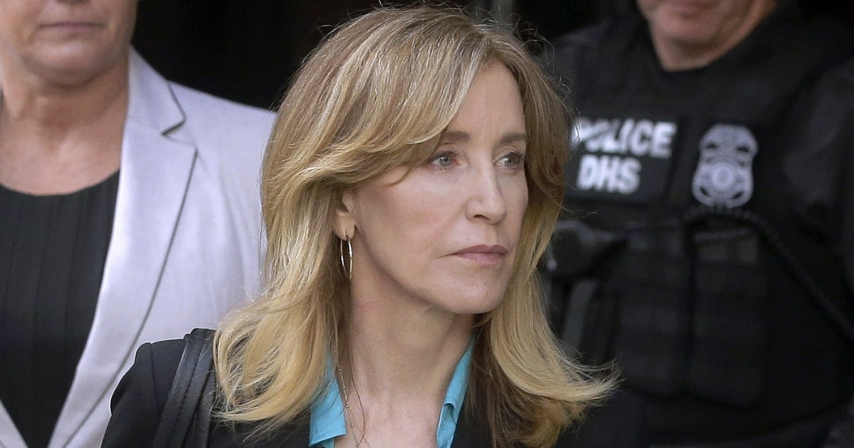 Felicity Huffman released two days before end of prison sentence for role in US college admissions scandal