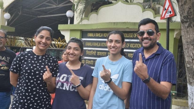 Celebrity chef Sanjeev Kapoor poses with family after casting his vote
