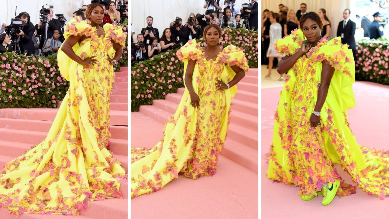 Serena Williams paired designer sneakers with neon yellow strong-shouldered Versace gown with pink feathery and leaf appliqué. Twitter/@MEfeatermagazine