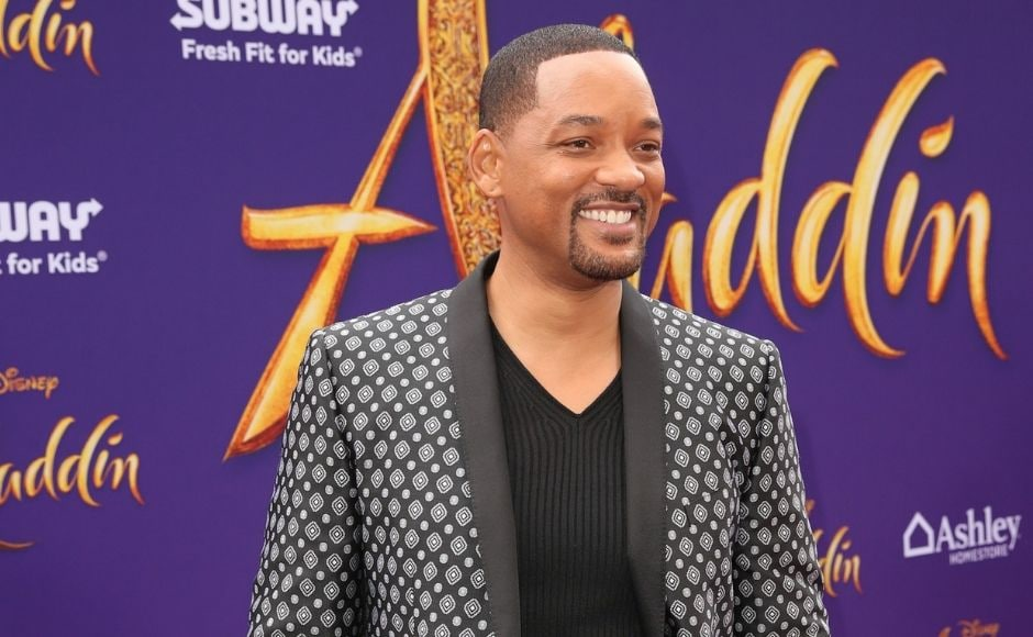 Will Smith sported a intricately designed grey and black jacket (in sync with his Genie character) for the world premiere