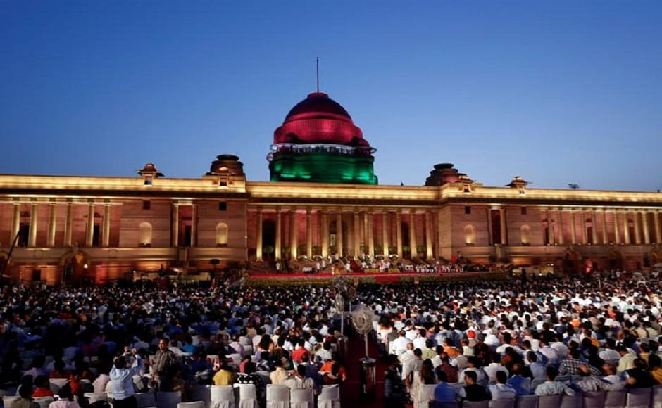 As the sun set over the Rashtrapati Bhavan, the two-hour swearing-in ceremony commenced with 8,000 people packing into the forecourt of the historic British-era presidential palace. In a grand ceremony with overtones of a US presidential inauguration, heads of state and government, chief ministers, India Inc honchos, opposition leaders, BJP members and showbiz stars rubbed shoulders as they watched President Kovind administer the oath of office. PTI