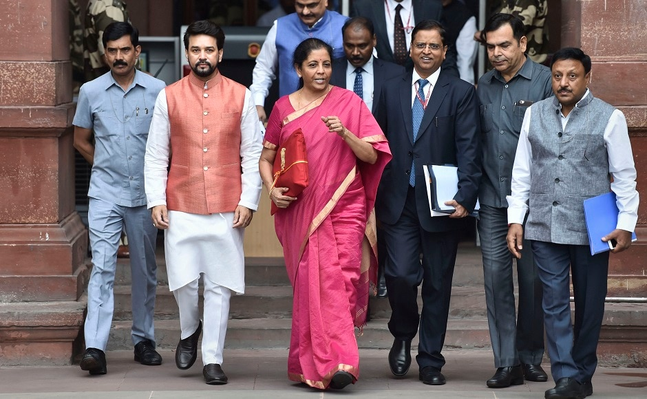 Minister of State Finance Anurag Thakur, Finance Secretary SC Garg, Chief Economic Adviser Subramanian and other officials were present with Sitharaman outside the Finance Ministry. PTI
