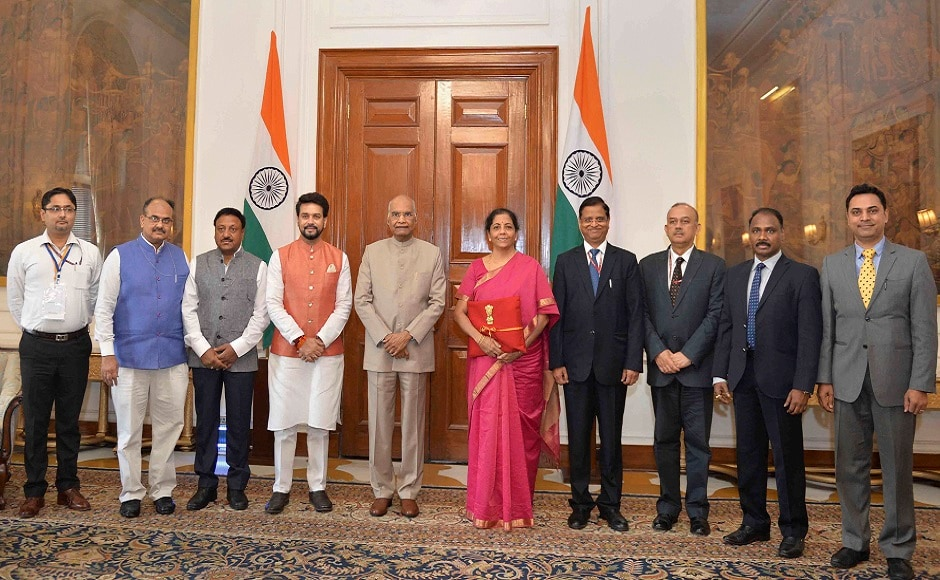 President Ram Nath Kovind posed for a photograph with Sitharaman, Thakur and her team ahead of the presentation of Union Budget. PTI