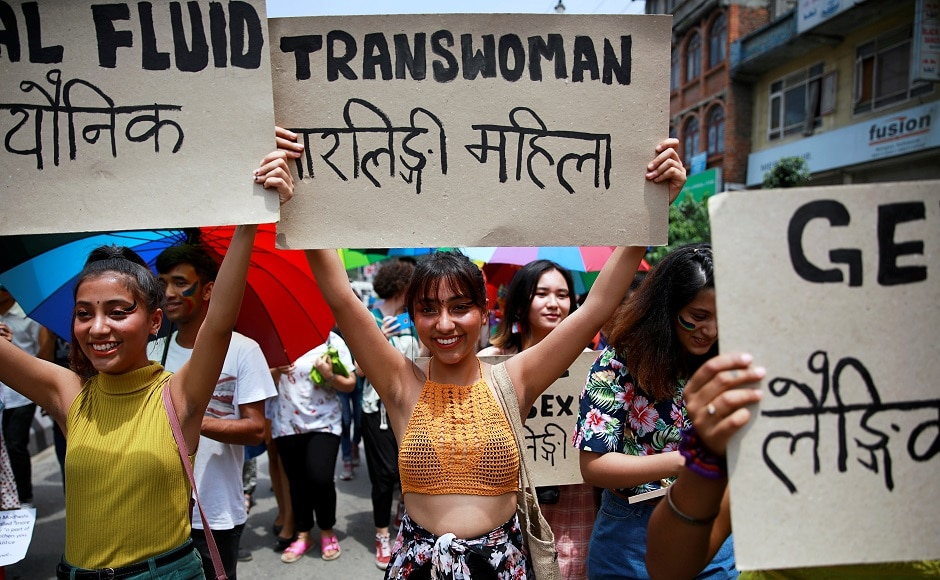 Participants hold up placards while taking part in a Gay Pride parade to mark pride month in Kathmandu, Nepal on 29 June, 2019. Reuters/Navesh Chitrakar