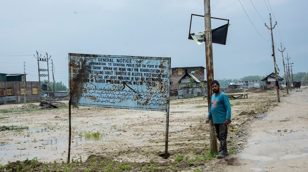 Government signboards indicating that the plots of land cannot be resold or sublet to non-Dal dwellers. Photo by Jennifer Kishan